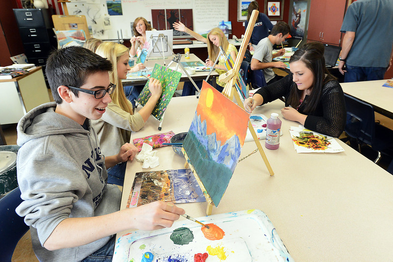 Resurrection Christian School students, clockwise from front left, Cooper Gillen, 17, Hannah Klein, 16, and Cecilie Stevenson, 15, work on acrylic on canvas paintings during 2-D art class Tuesday, Oct. 23, 2012.