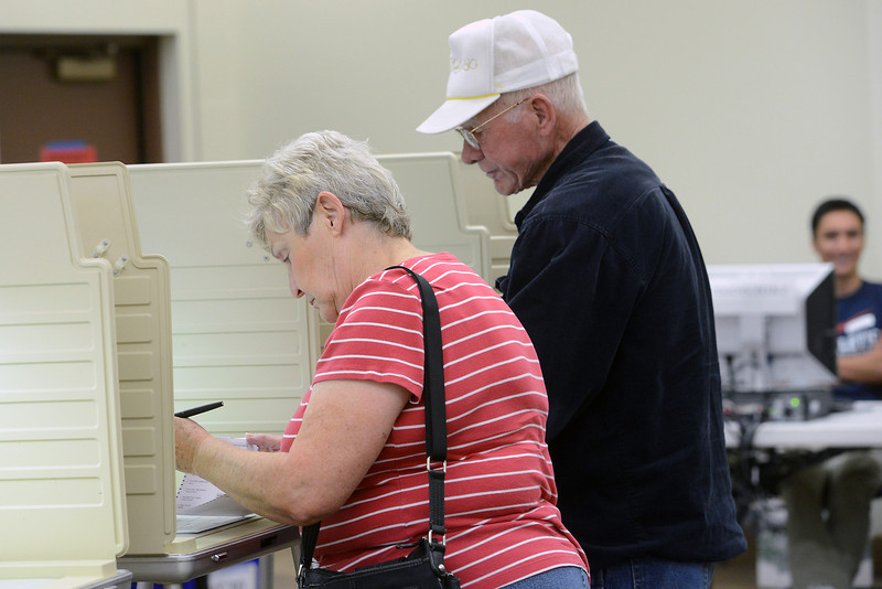 Loveland residents Nancy and Chad Bayne fill out their ballots Tuesday, Oct. 30, 2012 at a Larimer County Vote Center set up in the Loveland Police and Courts Building.