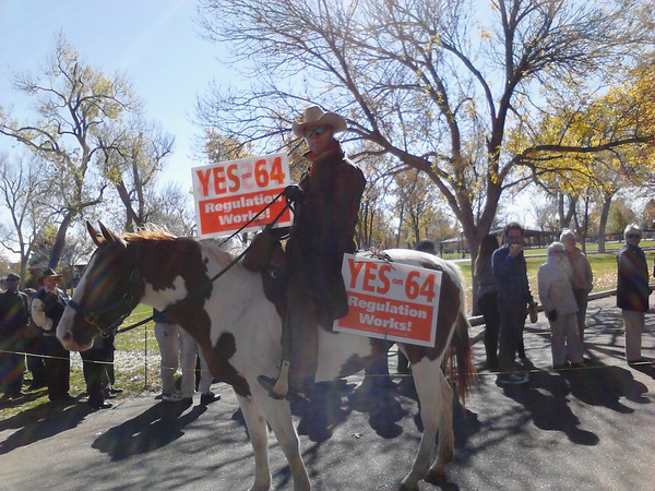 "Howard ""Cowboy"" Wooldrige and his horse Misty support Amendment 64 outside of Exhibition Hall."