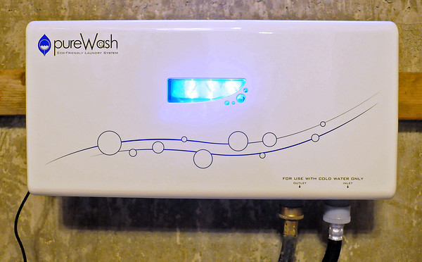 The light inside Danny Jackson's pureWash unit glows blue, indicating that it is working its magic on the water flowing through.