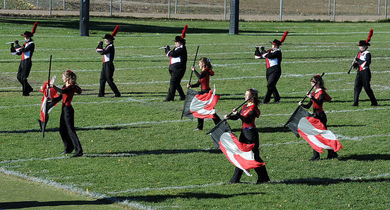 Members of the Roosevelt High School marching band and guard compete during the Colorado Band Masters Association Northern Colorado Marching Band Competition at Patterson Stadium Wednesday in Loveland.