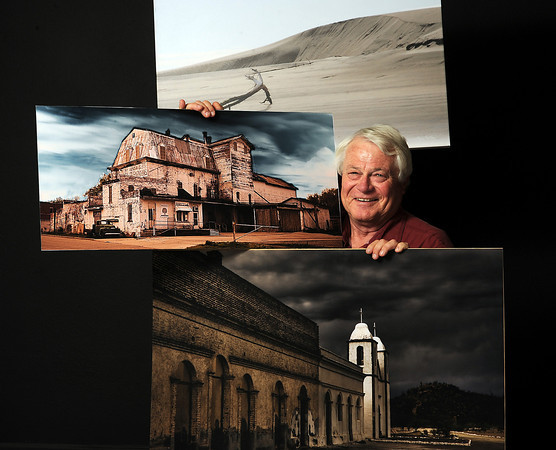 Gary Batha poses for a photo showing off some of his photographs Thursday in Loveland. Batha is heading up an artistic photo exchange between Loveland and La Paz, Mexico.