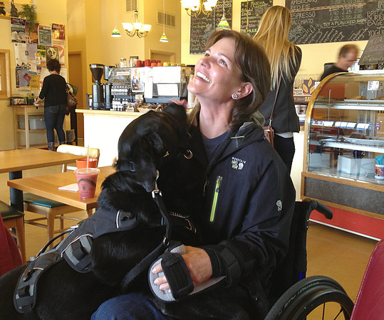"""Audrey Bocock, an Army veteran, is well-taken care of by her service dog. Bocock suffered a brain injury while serving in Iraq and will meet Trisha Downing on Thursday, the author of """"Cycle of Hope,"""" who writes about her own road to recovery after a brain injury."""