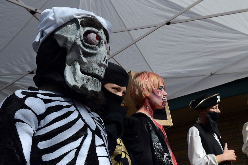Charles Dunsford, 10, left, stands with other youngsters for a costume contest during the Halloween Family Fun Festival on Oct. 27, 2012 in downtown Loveland.