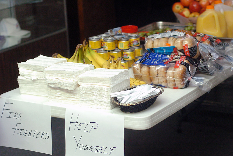 A table set up in the lobby of the Loveland Elks Club is loaded with a variety of food for the firefighters resting at the building Wednesday after working at the Reservoir Road fire.