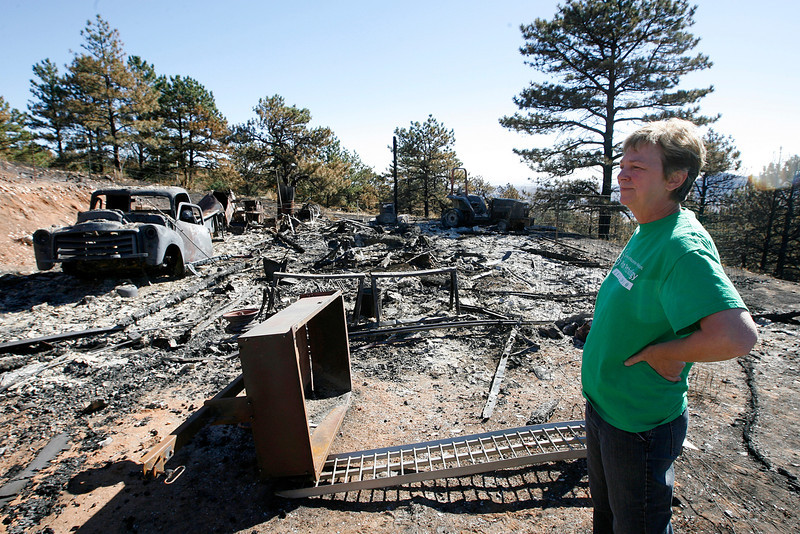 Jan Leach stands in front of her barn that burned down during the Reservoir Road Fire on Sunday. Leach and her husband, Ned Tisserat's house was was not touched by the flames. (Photo by Gabriel Christus)