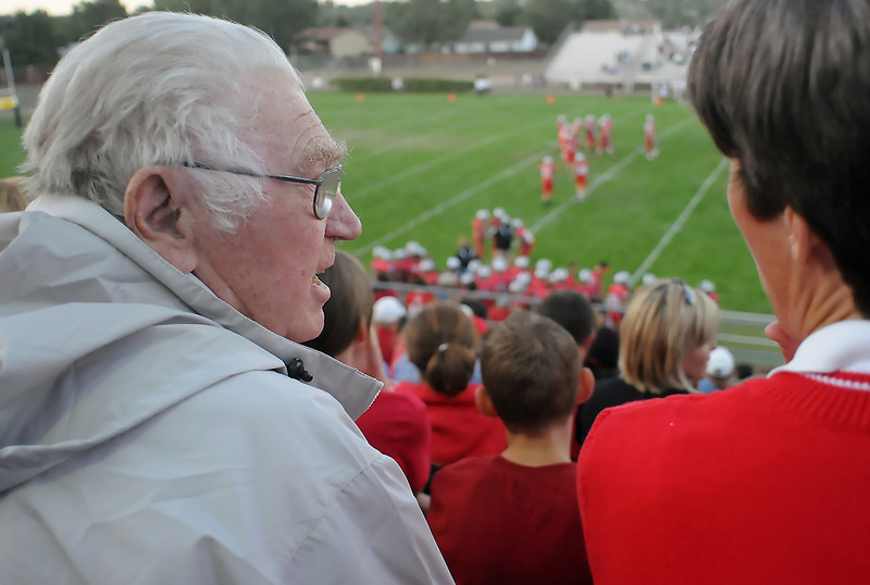 Bob Lebsack, left, chats with his daughter, Jackie Anderson, while they attend the Loveland High School football game together Thursday evening at Patterson Stadium where the Indians were taking on the Lambkins of Fort Collins.