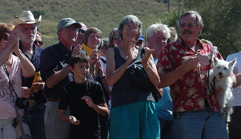 Evacuees of the Reservoir Road fire cheer as they learn they can return home Wednesday west of Loveland. Some of the residents from left are Carl Jett in the cowboy hat, Phil Hunger, Tyler DeForge, 11, and his grandmother Helen Grissom.
