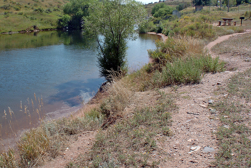 A trail winds its way along the southwest shore of Flatiron Reservoir where work is going to be done to improve access for visitors.