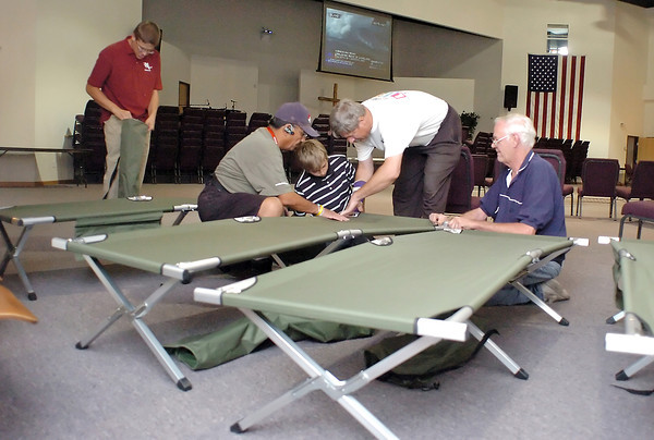 Volunteers set up cots Sunday in the auditorium of The Church at Loveland, 3835 SW 14th St., where an American Red Cross evacuation center was established for people displaced by the Reservoir Road fire west of Loveland.