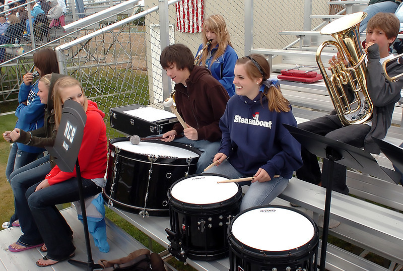 Resurrection Christian School football fans and the school's pep band cheer on the team during a game against Front Range Christian on Saturday at RCS. From left are Hannah Peterson, Tawna Sysum, Hailey Pearson, J.C. Fischer, Kellie Gadeken, Kathleen McCauley and Kyle Owen. The Cougars won, 28-0.