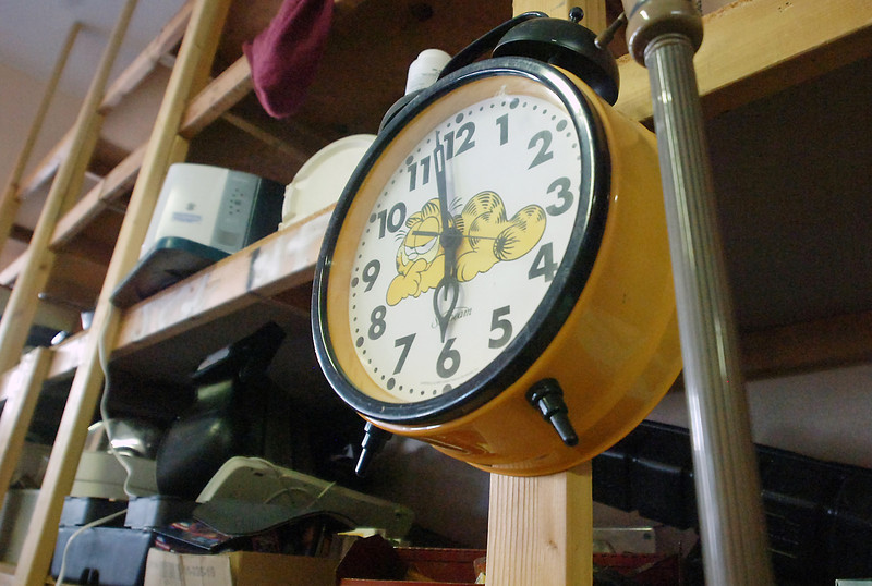 A Garfield alarm clock is among the items in the storage area of Rawhide Auctions, 349 Massachusetts Ave., in Berthoud.