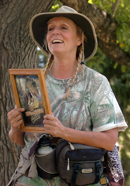 Paleontologist Connie Burkhart, also known as the Dinosaur Lady, gives a presentation about dinosuars to children from Loveland Preschool Friday at North Lake Park.