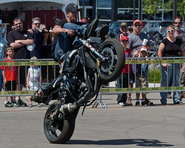 Suicical Lifestyles stunt rider Joe Trimbath of Loveland performs Sunday at the vendor booth area of the Thunder in the Rockies motorcycle rally.