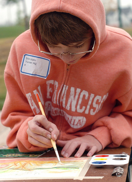 Thirteen-year-old Billy Klein of Berthoud works on a painting Saturday morning at Fairgrounds Park in Loveland during a class for Plein Air art students from the Thompson School District.