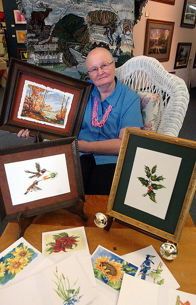 Mary Lee Leivestad is surrounded by her artwork as she poses for a portrait at Art of the Rockies in Loveland on Tuesday.