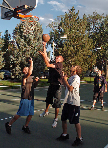 Several basketball players play a game of 21 together on the court at Dwayne Webster Veterans Park on Wednesday evening. From left are Danny Johnson, Jay Armstrong, Derrick Haley and Fabian Gonzales.