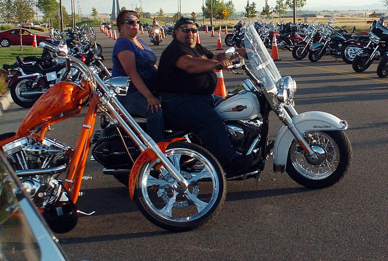 Frederick residents Roxanne and Joe Gallegos take off on their 2007 Harley Davidson Heritage Softail after attending the Thunder in the Rockies motorcycle festival on Saturday at the former Ferrero auto dealership on Byrd Drive east of Loveland.