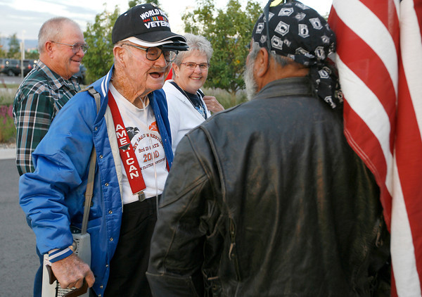 Rusty Hamill, a World War II veteran with the Navy, stops to talk with Max Ornelas, a Patriot Guard Rider, while his neighbors, Jerry and DeeAnn Ertle walk him into the Embassy Suites Sunday morning in Loveland. (Photo by Gabriel Christus)