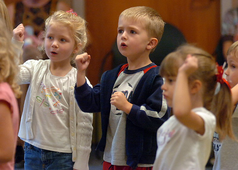 Children sing along to a song about trains Wednesday during storytime at the Loveland Public Library. From left they are Brenna McFarland, 4, Jacob Berg, 4, and Sydnie Atchley, 3.