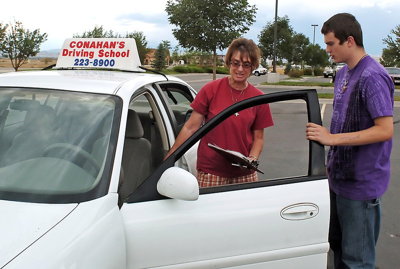 Driving instructor Gwen Moore, left, prepares to go driving with student Andrew Bernal, 15, on Monday by familiarizing him with the various features of the car they used for the lesson.