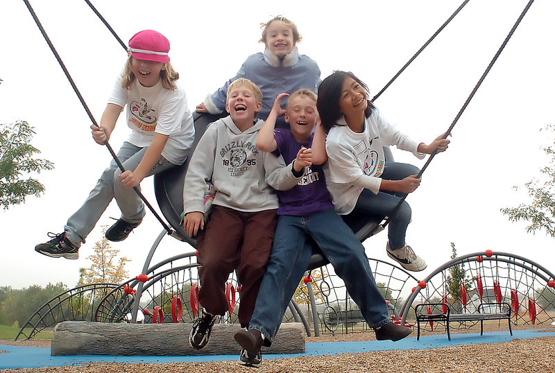 Youngsters share a laugh while swinging together Saturday at the Fairgrounds Park playground. From left to right are Anna Cormos, 10, Brendan Monroe, 10,  Jade Scarpulla, 10, Tanner Miller, 8, and Ern Mudge, 10.