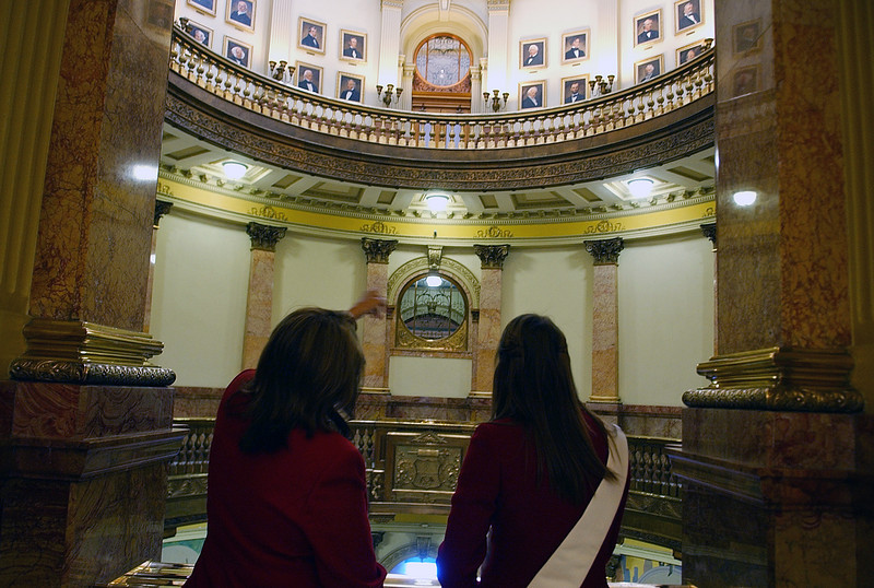 State Representative B.J. Nikkel, left, points out portraits to Loveland's Miss Valentine, Hillary Skeffington, during her visit to the Capitol on Tuesday, Feb 10.