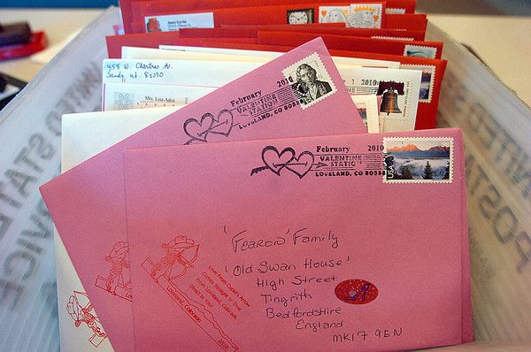 A box of Valentines that are stamped and ready to be delivered to the post office will be sent to folks around the world.