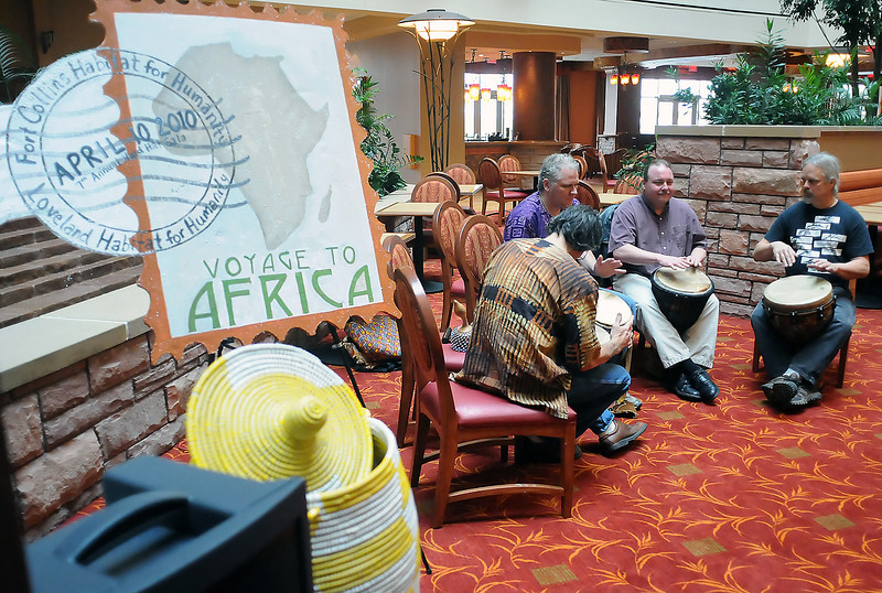 Members of the northern-Colorado based Stone People Drummers perform Wednesday morning at the Embassy Suites Loveland during a kickoff event for a fundraiser for the Loveland and Fort Collins branches of Habit for Humainty. From left are Mark Unger, Matt Unger, Josh Rabe and Richard W. Bender.