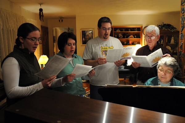 The Johnson family sings around the piano at the home of Judy Johnson, seated and her husband Murrell. The family often sings together at church. Pictured with their parents are, from left, Shauna, Angela and Craig. Another son, Neal, is away in England on a mission trip.