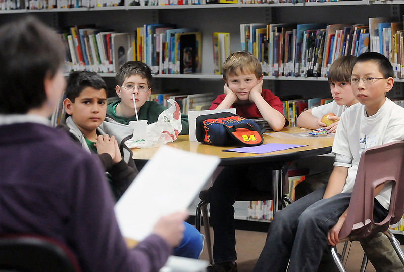 Berthoud Elementary School fifth graders listen as Cindy Strandvold reads aloud Wednesday in the school's library from the manuscript of one of the books she has written. A group of students from Cindy's Fan Club meets each Wednesday during their lunch period to listen to stories by Strandvold. At rear from left are Gabriel Vigil, 10, Jack Klein, 11, Peter Kasperbauer, 10, Zane Teunissen, 11, and Caleb Jordan, 11.