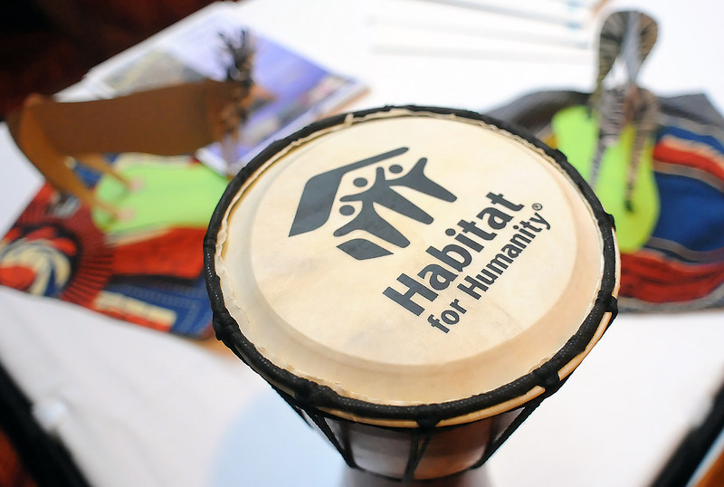 A drum with the Habitat for Humainty logo sits among African-themed cloth and animal statues on a table at the Loveland Embassy Suites during a kickoff for the group's upcoming fundraiser called Voyage to Africa.