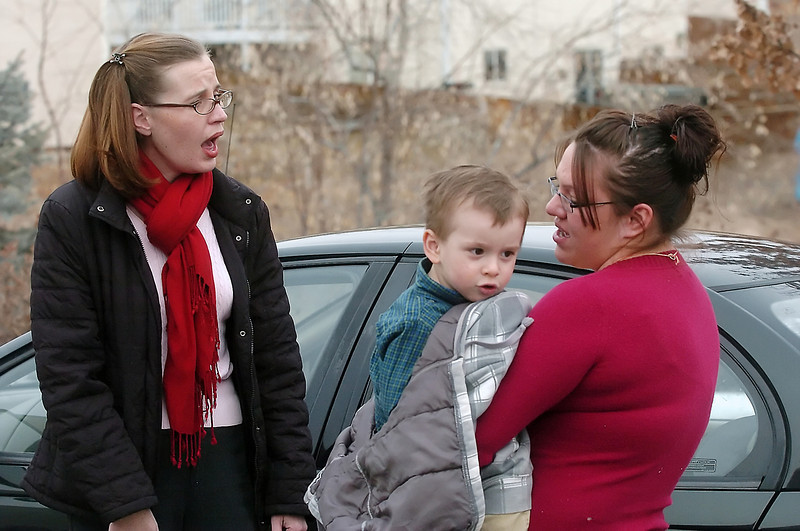 Marlana Rivera holds her son, Ryan Witman, 2, while chatting with Nicolle Gregg after they met for the first time Wednesday at Project Self-Sufficiency in Loveland where Gregg recently donated her 10-year-old Saturn car, seen at rear, to the program and Rivera became its new owner.