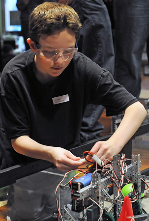 Tanner O'Leary of Berthoud High School's robotics team Heavy Metal changes out the batteries on his team's robot during an elimination match competition for the VEX Robotics Championship on Saturday, Feb. 6, 2010 at BHS.