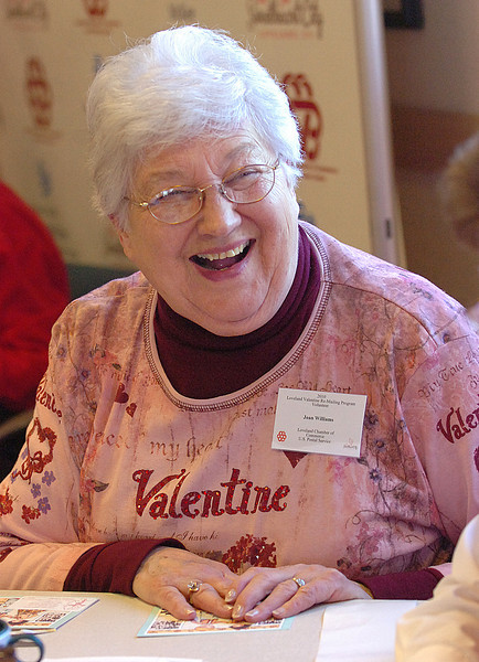 Sporting a Valentine t-shirt, Joan Williams shares a laugh with other volunteers during the kick off to the Loveland Valentine Re- mailing Program. Williams said she has around ten different shirts she wears while stamping Valentines. One for almost everyday she stamps.