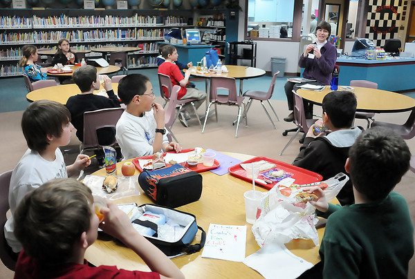 Cindy Strandvold talks with Wednesday students at Berthoud Elementary School about an item she used for inspiration for one of the books she has written. Each Wednesday fifth graders in Cindy's Fan Club spend their lunch period listening to stories by Strandvold.