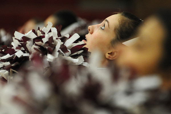 "Berthoud High School freshman Jessica Wilcox, 15, cheers ""more power to the hour"" with the cheerleading squad during the first half of Tuesday night's girls basketball game against Thompson Valley High School. The Spartans fell to the Eagles XXX-XXX during the home game."