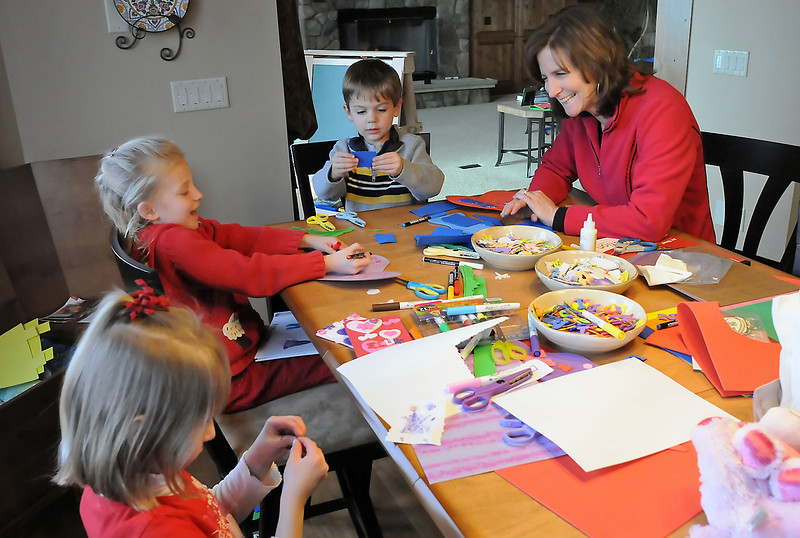 Miss Loveland Valentine from 1987 Andrea Mead helps her children Carson Mead, 4, and Ellie Mead, 5, and Ellie's friend, Abbey Sandberg, 5, to make Valentine's cards at her Berthoud home on Friday, Feb. 12, 2010.