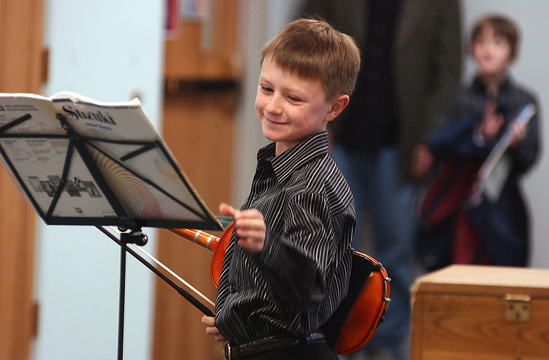 Bailey Hamrick proudly finishes his violin audition for the Kiwanis Stars of Tomorrow Talent Show Saturday, Feb 27, at the United Methodist Church.
