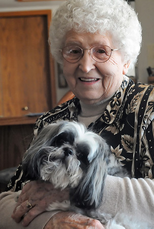 Tillie Edwards, who turns 100 on Feb. 12, 2010, holds her dog, Maggie, on Thursday afternoon in her Loveland home.