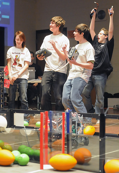 Members of Berthoud High School's robotics team Heavy Metal react after winning their semi-final elemination match during the VEX Robotics Championship on Saturday, Feb. 6, 2010 at BHS. From left are Emily Birkmaier, 18, Jon Neuhalfen, 15, Clayton Rayment, 14, and Tanner O'Leary, 16.