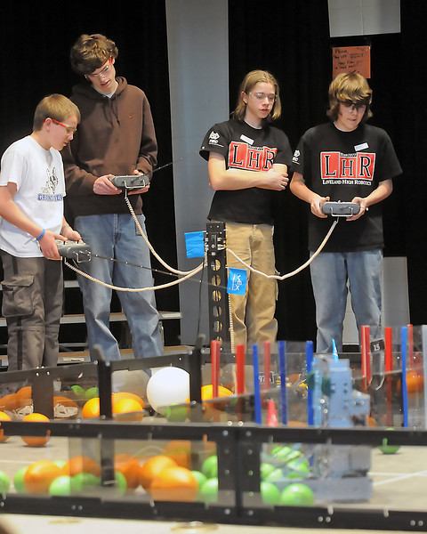 Teams compete in an elimination match during the VEX Robotics Championship on Saturday, Feb. 6, 2010 at Berthoud High School. From left are Tyler Parker, 15, and Nick Coulter, 17, of Grandview High School and Gavin Stewart, 15, and Harry Houlton, 14, of Loveland High.