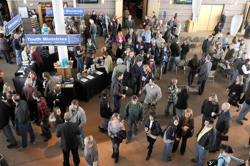 Churchgoers mingle between Sunday services at Crossroads Church. A study done by Group Publishing found that people are using church less and less for meeting friends. Other draws like social media and sports bars have replaced it as potential meeting places for friends.