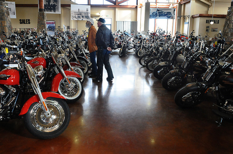 Chip Hayden, left, and Bob Starck of Johnstown peruse the showroom at Thunder Mountain Harley Davidson on Tuesday. Engaging Loveland is exploring whether the Thunder in the Rockies motorcycle rally can be held in downtown.