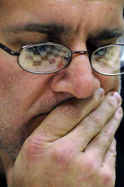 Don Wisdom of Aurora eyes a chessboard as he tries to outwit opponent Frank Deming of Fort Collins during the 37th annual Loveland Open Chess Tournament at The Ranch on Sunday.