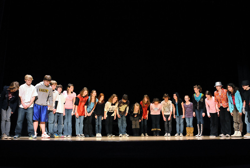 "Bill Reed Middle School students practice their bow at the end of a rehearsal for the Loveland Integrated School of the Arts (LISA) performance of ""Bill Reed Presents A Variety Show"" at the Rialto Theater on Thursday."