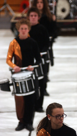Rebekah Christensen plays the marimba while the rest of Loveland High School's drum line performs behind her Sautrday, Feb 27.