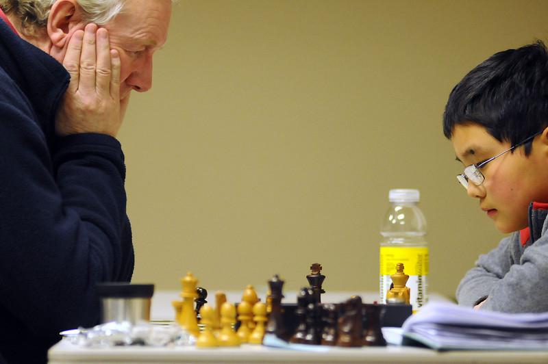 Gerry Morris of Littleton, left, plays Jackson Chen, 11, of Broomfield to a draw on Sunday during the 37th annual Loveland Open Chess Tournament.