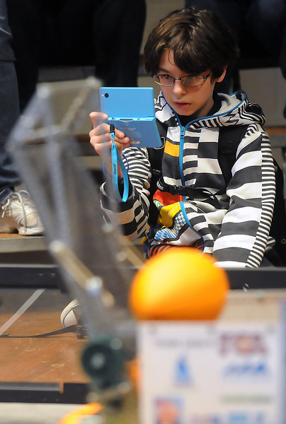 Thirteen-year-old Bryan Montero of Estes Park uses his Nintendo DSi to take pictures of robots competing in the VEX Robotics Championship on Saturday, Feb. 6, 2010 at Berthoud High School. Bryan said he hoped to join a team to compete in a future event and that his favorite robot was the 15C entry from Loveland High School's Team Loveland.