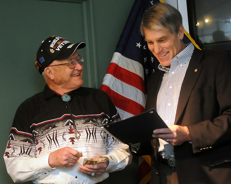 Ret. Senior Chief Petty Officer and World War II veteran William M. Dudley, left, shares a laugh with Sen. Mark Udall as he receives an Honroable Service Lapel Pin, which is also known as the Ruptured Duck, during a ceremony Saturday at the Loveland Museum/Gallery to award Dudley with several commemorative medals and decorations minted to honor and commemorate his service in the U.S. Navy. Dudley lives near Eaton and was awarded the following: Navy Good Conduct Medal; World War II Victory Medal; American Campaign Medal; Asiatic Pacific Campaign Medal with four bronze stars; Combat Action Ribbon; Naval Reserves Meritorious Service Medal with two bronze stars; Armed Forces Reserve Medal; Naval Reserve Medal; Discharge Button and the Honorable Service Lapel Pin.